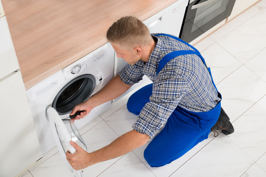 Worker In Overall Fixing Washer Quick Appliance Repair